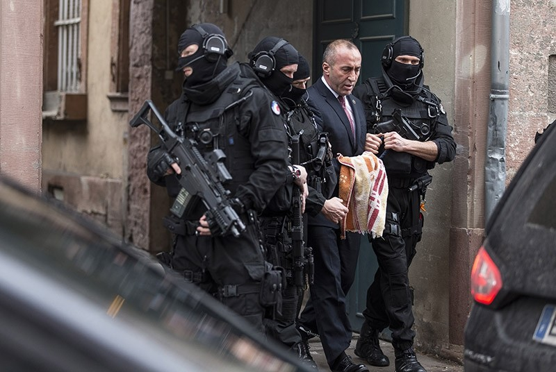Former PM of Kosovo Ramush Haradinaj, second right, leaves the court escorted by hooded police officers in Colmar, eastern France on Jan. 12, 2017. (AP Photo)