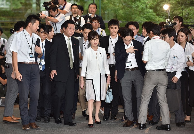 Newly appointed Japanese Defense Minister Tomomi Inada (C) is surrounded by the media during a visit to the prime minster's official residence in Tokyo on August 3, 2016. (AFP Photo)