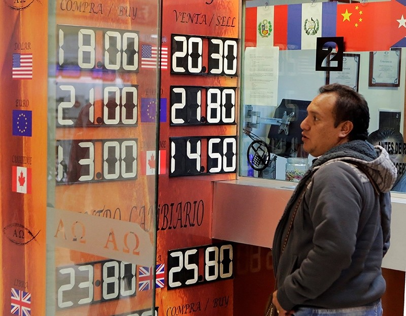 A board displaying the exchange rates of Mexican peso against the U.S. dollar and the euro is seen at a foreign exchange house at the international airport in Mexico City, Mexico November 8, 2016. (Reuters Photo)