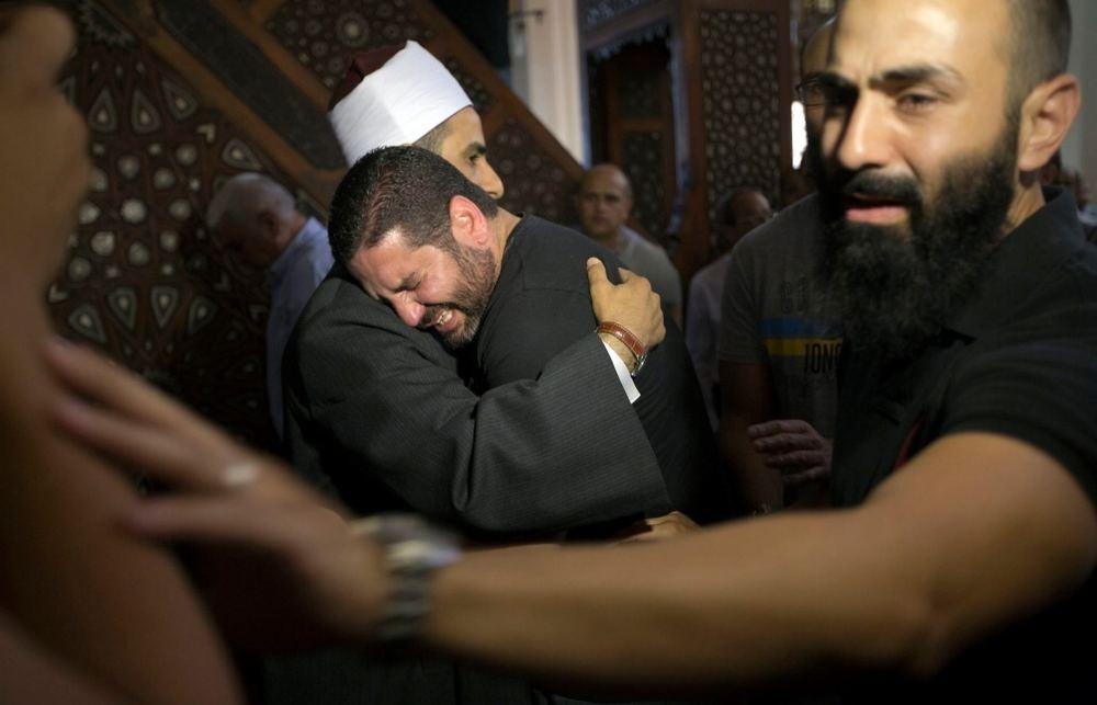 The Imam of al Thawrah Mosque gives condolences to an Egyptian man who lost four relatives, all victims of Thursday's EgyptAir plane crash.