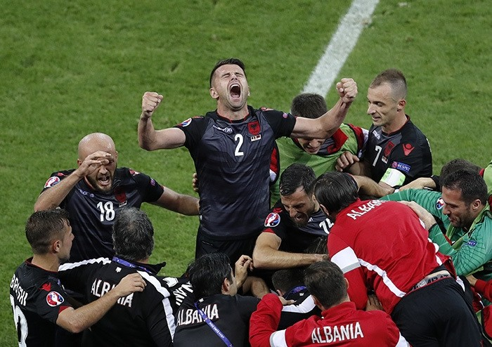 Albania's Andi Lila shouts raising his arms while celebrating his team's opening goal during the Euro 2016 Group A soccer match between Romania and Albania at the Grand Stade in Decines-Charpieu, near Lyon, France, Sunday, June 19, 2016. (AP Photo)