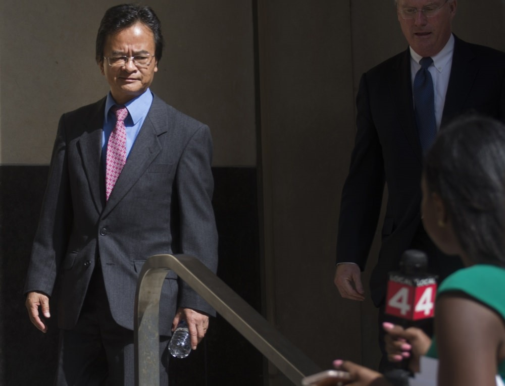 Volkswagen engineer James Robert Liang, left, leaves court in Detroit, after pleading guilty to one count of conspiracy in the companyu2019s emissions cheating scandal, Liang has agreed to cooperate in the widening criminal investigation.