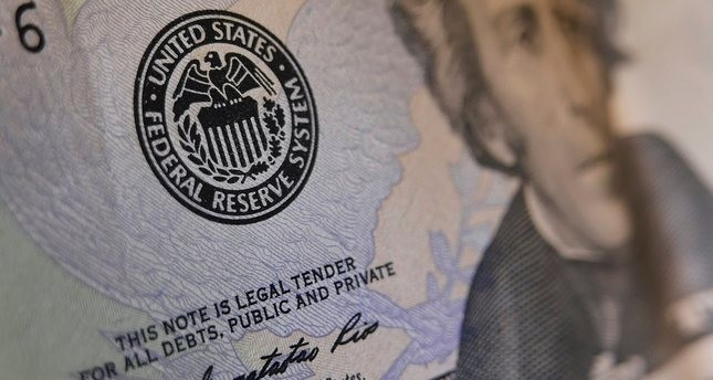 THE SEAL OF THE FEDERAL RESERVE IS SEEN ON A US BANKNOTE ON JUNE 1, 2016 IN WASHINGTON, DC. (AFP Photo)