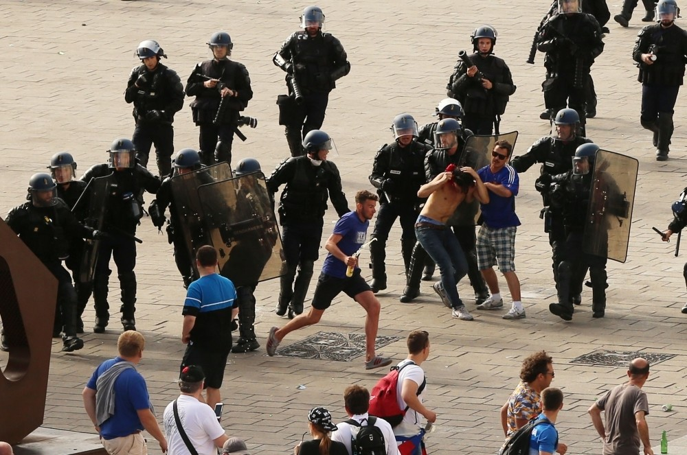 French riot police moving in to detain Russian football fans after violence broke out between supporters ahead of the England vs Russia Euro 2016 football match, in Marseille on June 11, 2016.