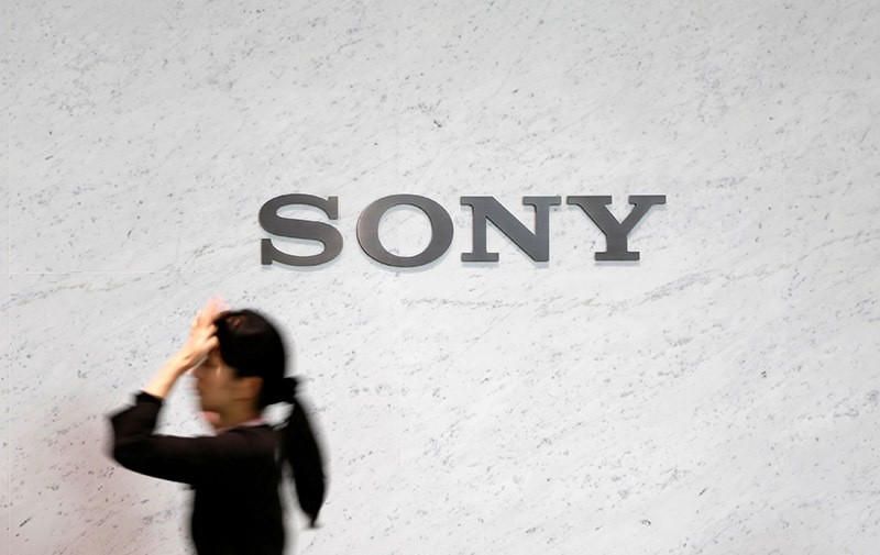 A reception staff walks under a logo of Sony Corp at its headquarters in Tokyo February 4, 2015. (Reuters Photo)