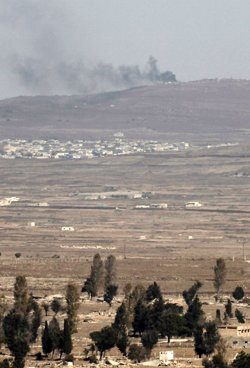 A picture taken from the Israeli-annexed Golan Heights shows smoke rising from a Syrian army position on November 9, 2016. (Photo AFP)