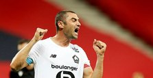 Burak Yılmaz's double sends Lille to knockout stages