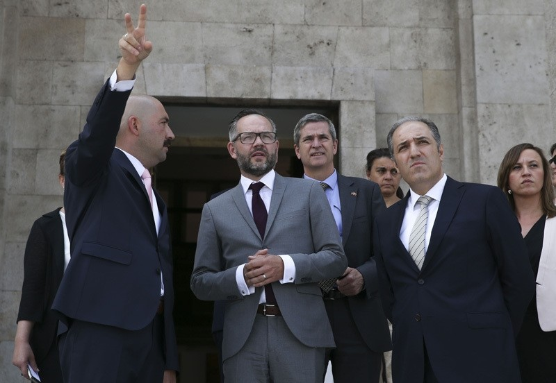 Chairman of Parliament's Human Rights Investigation Commission Mustafa Yenerou011flu (R) gives tour of the bombed Turkish Parliament to German Minister of State for Europe Michael Roth (M) along with his delegation on August 26, 2016.  AA Photo