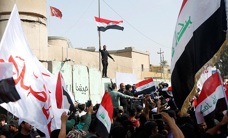 Supporters of Iraqi Shiite cleric Muqtada al-Sadr shout slogans during an anti-Turkey protest in front of the Turkish embassy in Baghdad, Iraq October 18, 2016. (Reuters Photo)