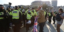 Police arrest 32 after anti-lockdown protest violence in London