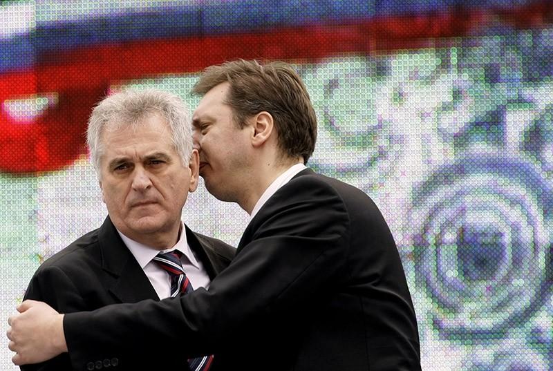 Serbian Prime Minister Aleksandar Vucic, right, speaks with Serbian President Tomislav Nikolic during a protest rally in Belgrade, Serbia. (AP file photo)