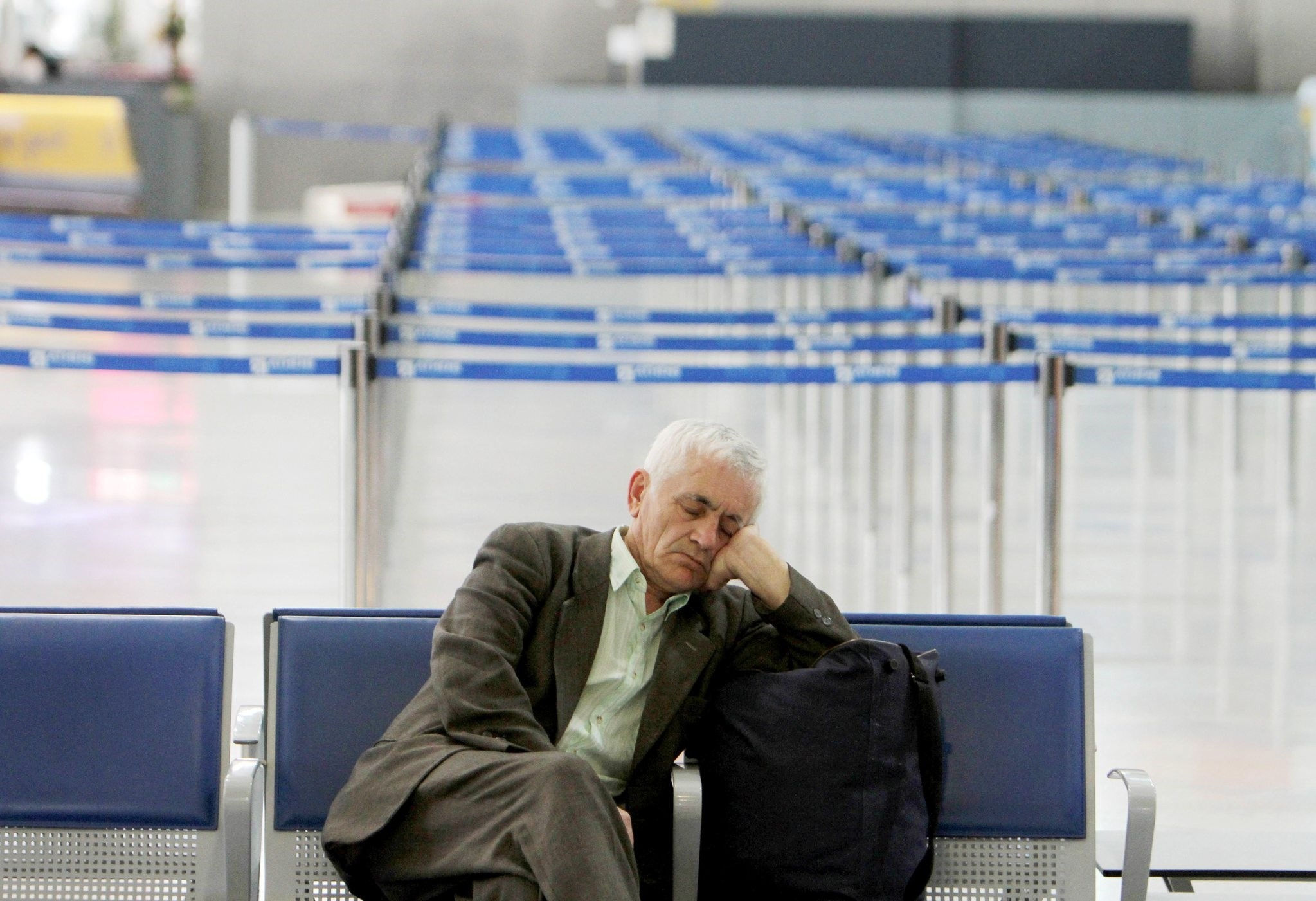 A passenger sleeps during a strike at the Athens International Airport Eleftherios Venizelos in Spata on Wednesday, Feb. 24, 2010. (AP Photo)