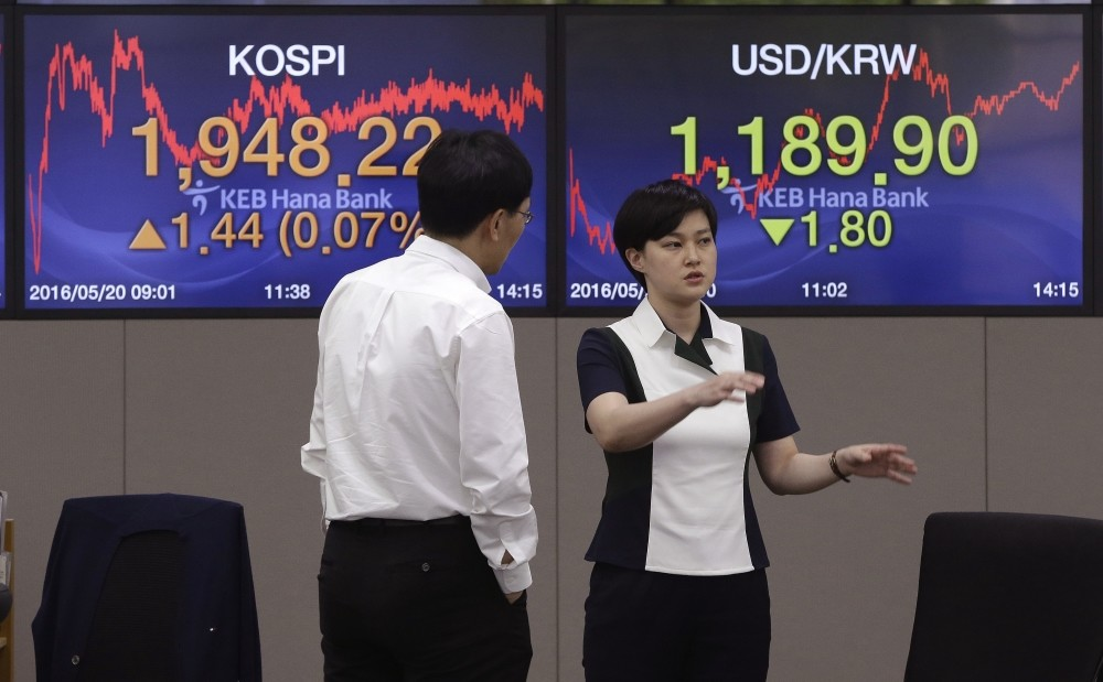 Currency traders work at the foreign exchange dealing room of the KEB Hana Bank headquarters in Seoul, South Korea.
