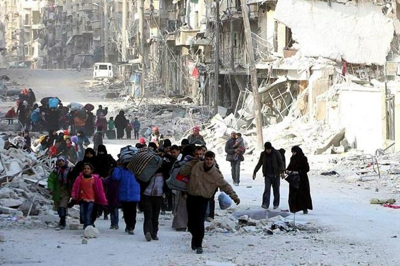 Displaced Syrian families leave the neighborhoods where the fighting occurs in eastern Aleppo, Syria, Nov. 29.
