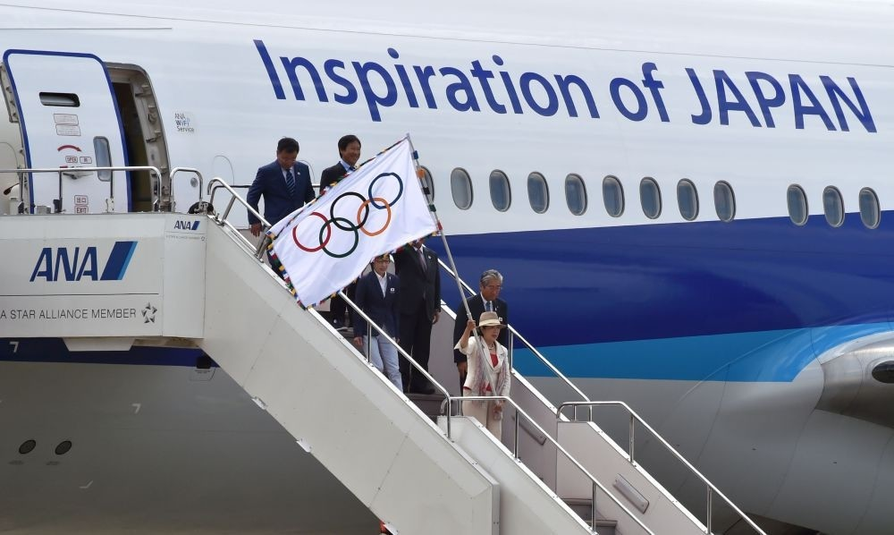 Tokyo Governor Yuriko Koike waves the Olympic flag upon arrival at Haneda international airport in Tokyo. The Olympic flag arrived in Tokyo, host of the next 2020 Summer Games.