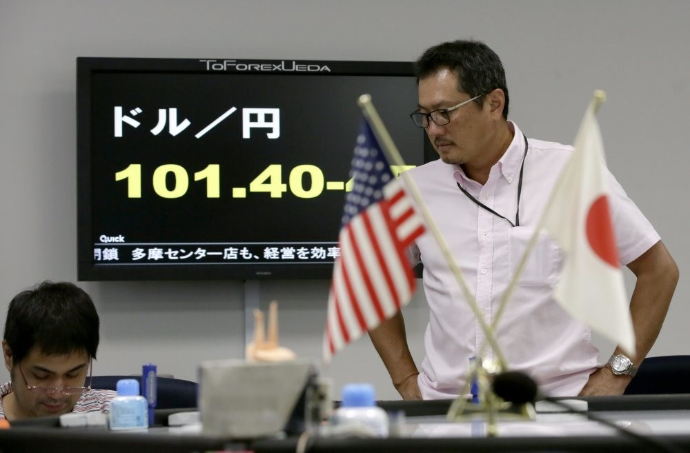 Tokyo money dealers working during an afternoon trading session in Tokyo, Japan, on Sept. 7 2016. The dollar dropped to lower the level of 101 Japanese yen, down about 1.9 yen.