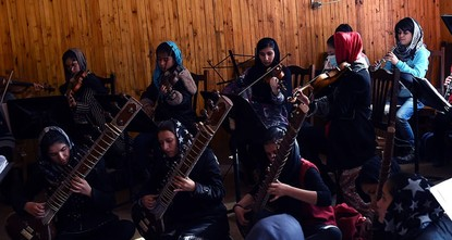 pTeenager Negin Khapalwak is the first ever female conductor of an only all-girl orchestra in Afghanistan. On Friday, her group is due to play the closing concert at the World Economic Forum in...