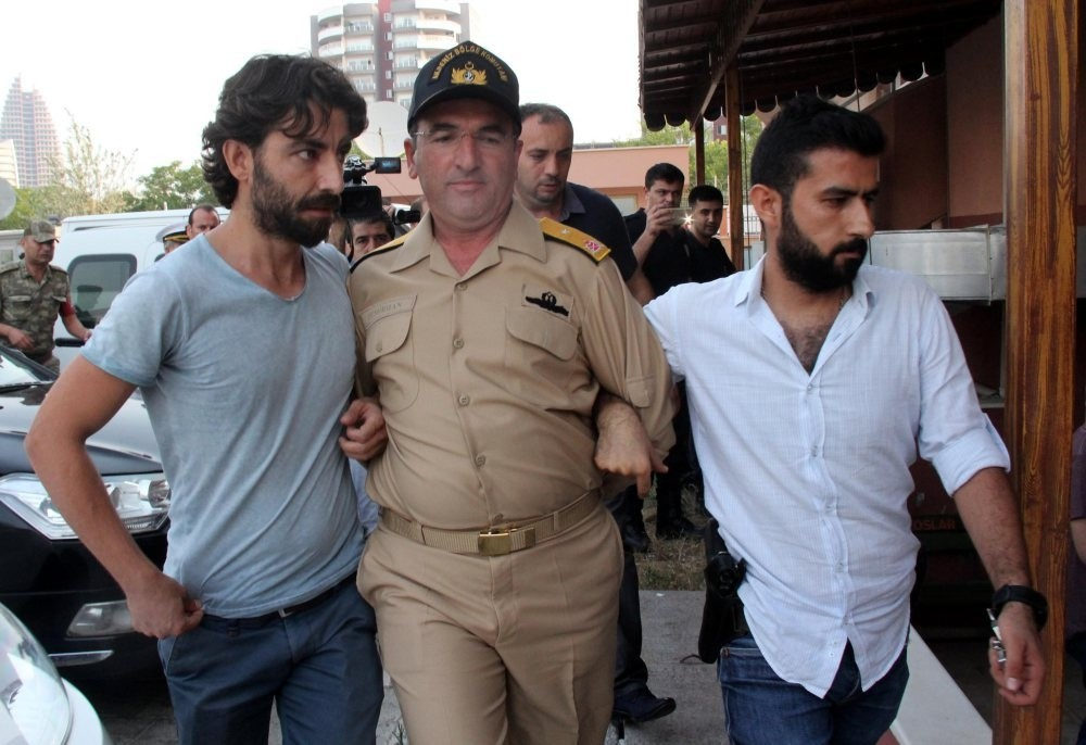 Adm. Nejat Demirhan detained on coup charges is also among detainees in plot case.