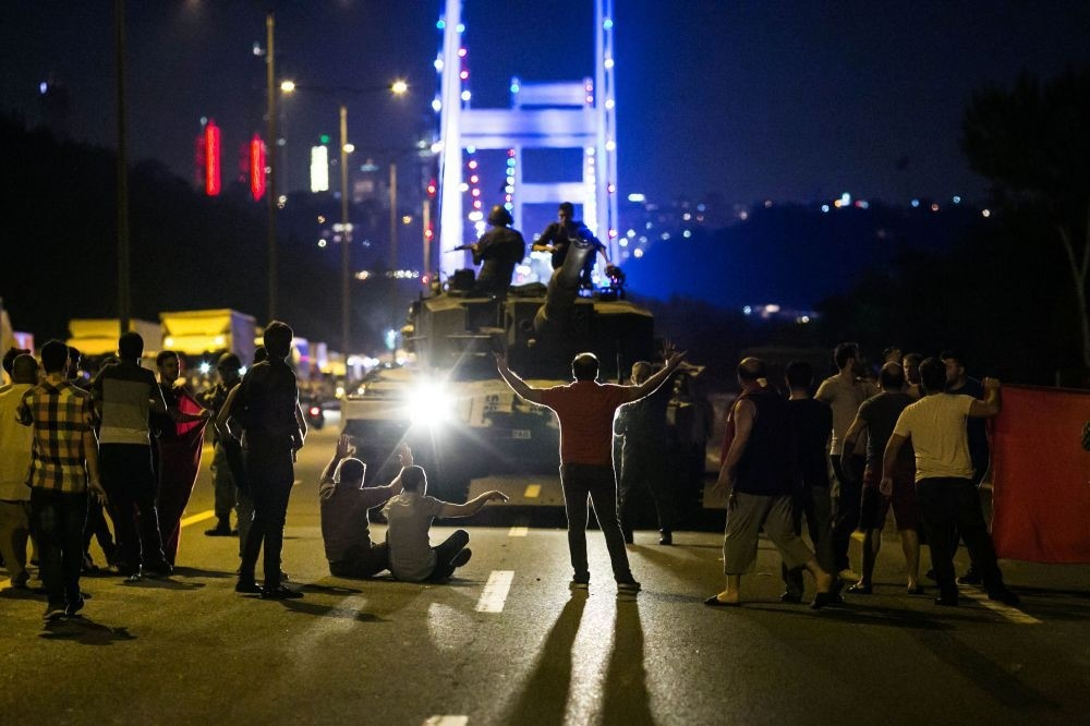 People confront tanks on the coup night near an Istanbul bridge. Strategic locations in the city faced threat of takeover by putschists by strong public resistance helped quelling the coup attempt.