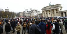 Thousands of Berliners rally to protest Merkel's virus plans