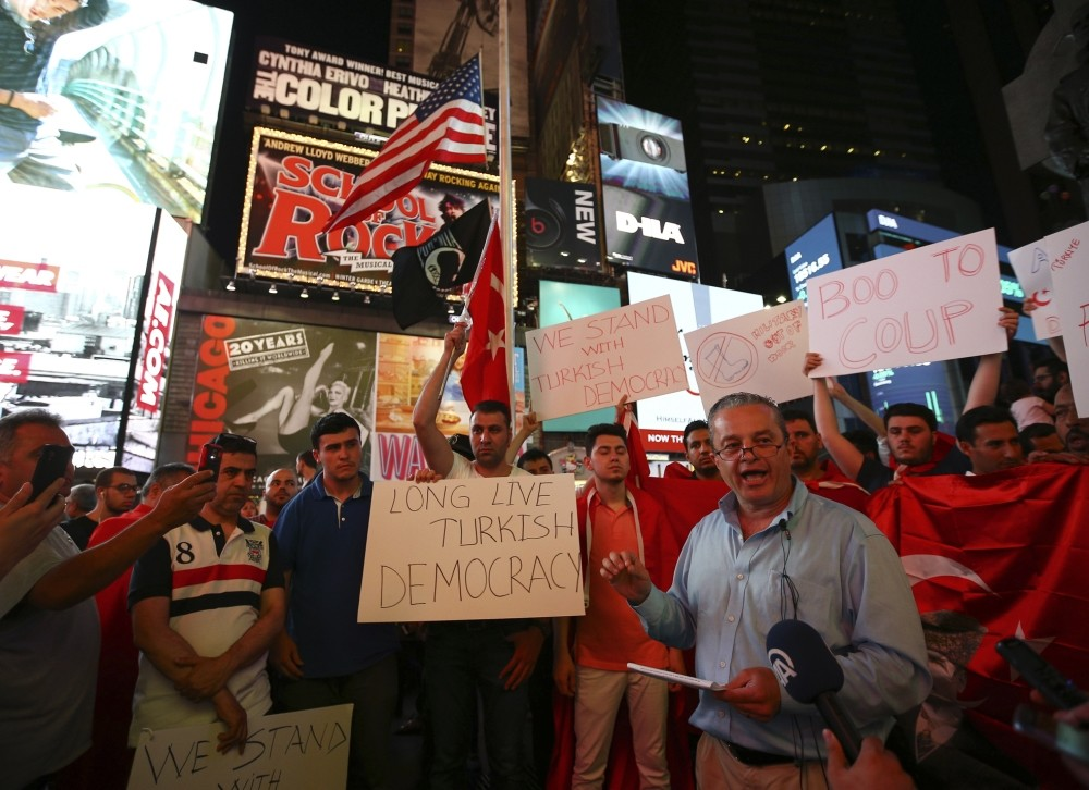 Turkish community activist Ibrahim Kurtuluu015f speaks in front of crowd protesting the attempted coup, in Times Square, New York.