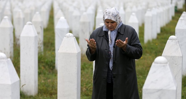 Hatidza Mehmedovic prays near the graves of her two sons and husband in Potocari near Srebrenica, Bosnia and Herzegovina, October 17, 2016. (Reuters Photo)