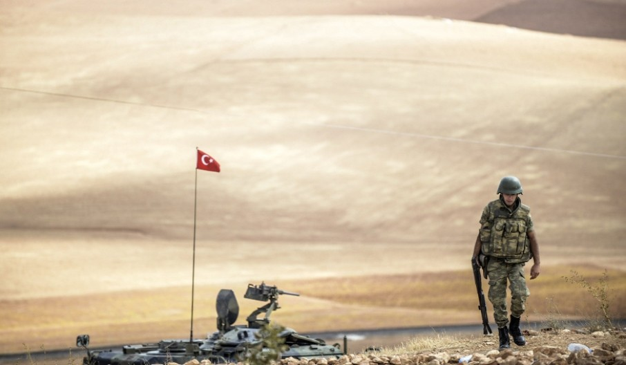 A Turkish soldier patrolling near the Syrian border in the southeastern town of Suruu00e7, u015eanlu0131urfa, on Sept. 30, 2014.