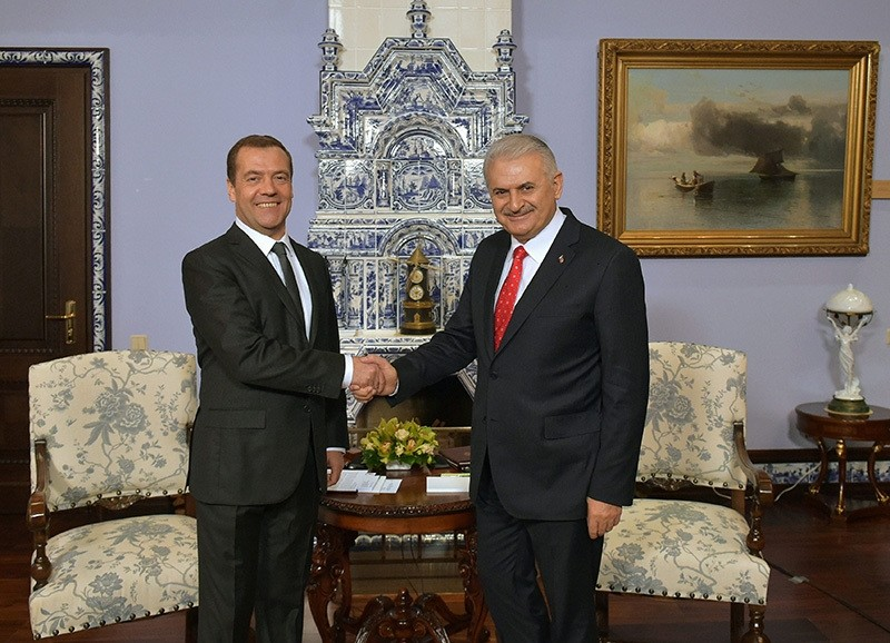 Russian Prime Minister Dmitry Medvedev, left, meets with Turkish Prime Minister Binali Yildirim at the Gorki residence outside Moscow on Tuesday, Dec. 6, 2016. (AP Photo)