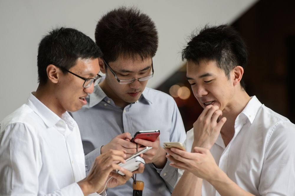 People play u201cPokemon Gou201d in the Central district of Hong Kong Tuesday.