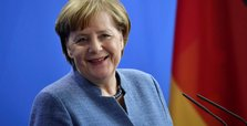 Merkel voices 'full solidarity' with Juncker in Orban row