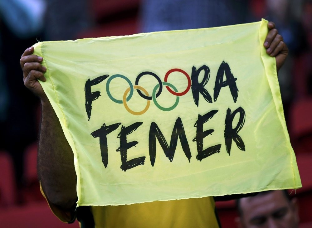 A banner reads ,Out Temer, in reference to the interim Brazilian President Michel Temer.