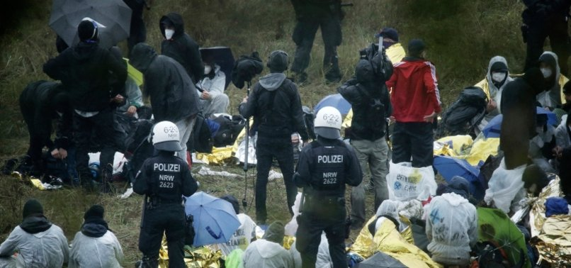 HUNDREDS OF ANTI-COAL CAMPAIGNERS PROTEST AT GERMAN MINE