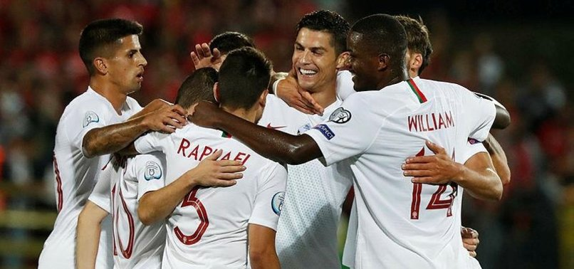 RONALDO HITS FOUR AGAINST LITHUANIA TO TAKE PORTUGAL TALLY TO 93