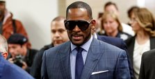 R. Kelly arrested in Chicago on child pornography charges