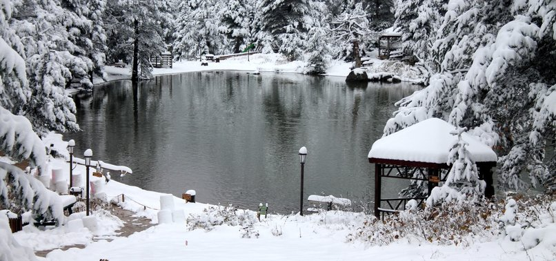 WINTER FAIRY TALE IN MAY: SNOW COVERS LIMNI LAKE PARK IN TURKEYS GÜMÜŞHANE