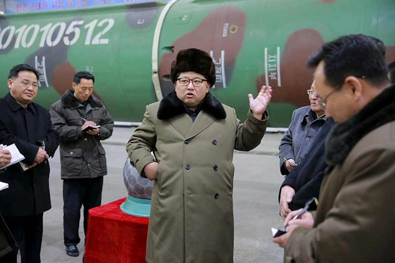 North Korean leader Kim Jong Un meets scientists and technicians in the field of research into nuclear weapons in this undated photo released by North Korea's Korean Central News Agency (KCNA) in Pyongyang, March 9, 2016. (Reuters Photo)