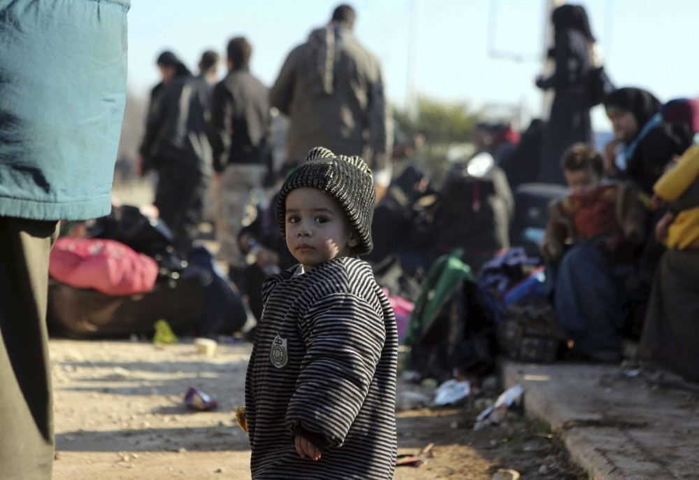 A young Syrian child evacuated from the embattled Syrian city of Aleppo during the ceasefire arrives at a refugee camp in Rashidin, near Idlib, Syria.