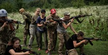 Children, teens receive arms training in western Ukraine far-right summer camp