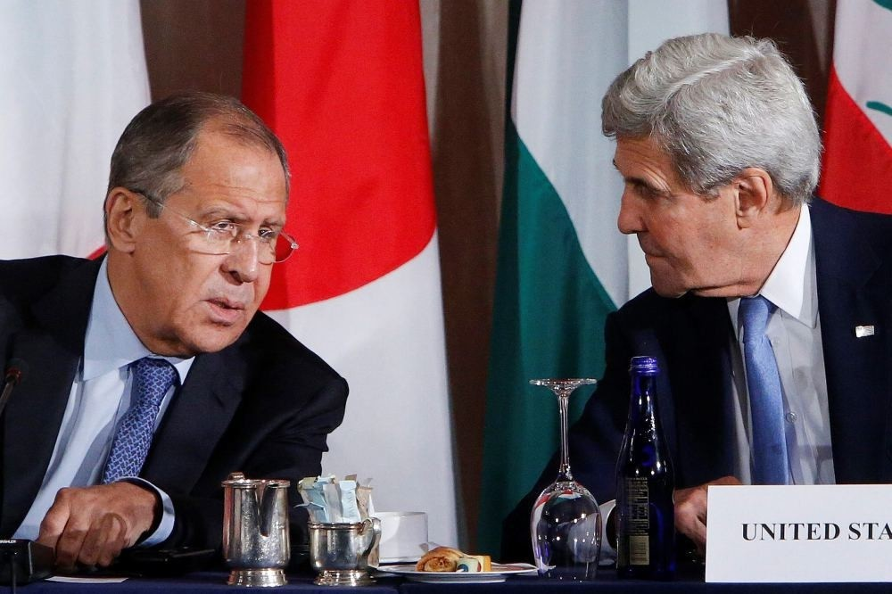 Russia's Foreign Minister Sergey Lavrov and United States Secretary of State John Kerry talk during a meeting at the International Syria Support Group, Sept. 22 in New York.