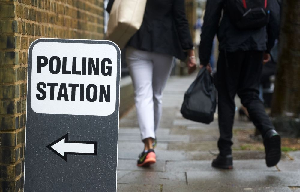 People leaving a polling station in London yesterday, as Britain holds a referendum on whether to remain in or to leave the European Union.