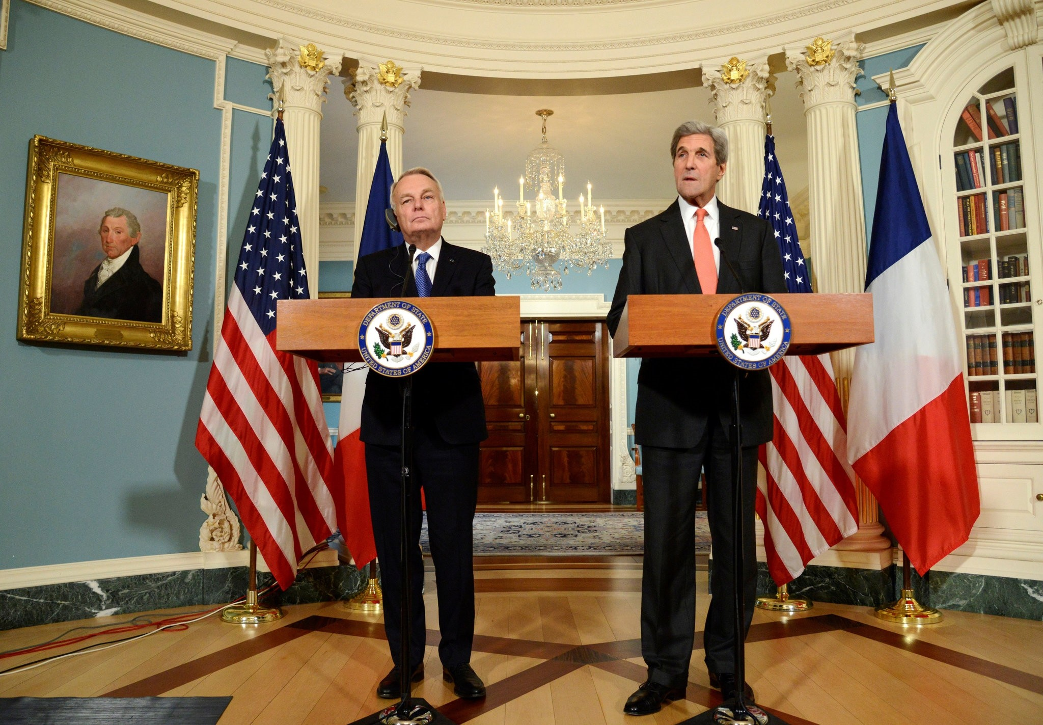 U.S. Secretary of State John Kerry (R) makes a statement with French Foreign Minister Jean-Marc Ayrault. (Reuters Photo)