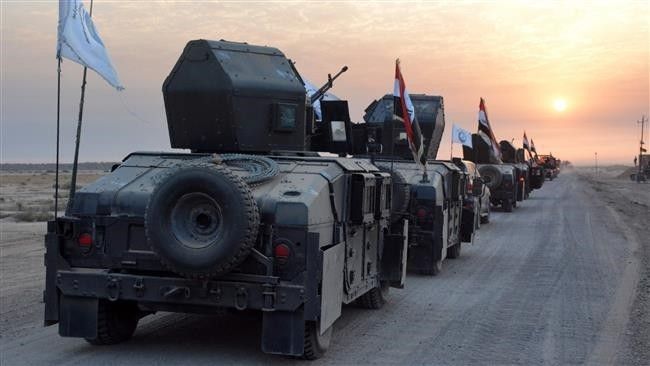 Iraqi military vehicles in eastern Salaheddin province, south of Hawijah, on October 10, 2016.