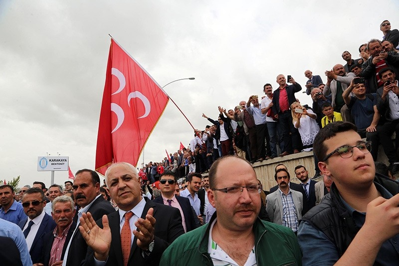 Supporters of dissidents in MHP await in front of police barricade during the emergency convention attempt in Ankara on May 14. (DHA Photo)