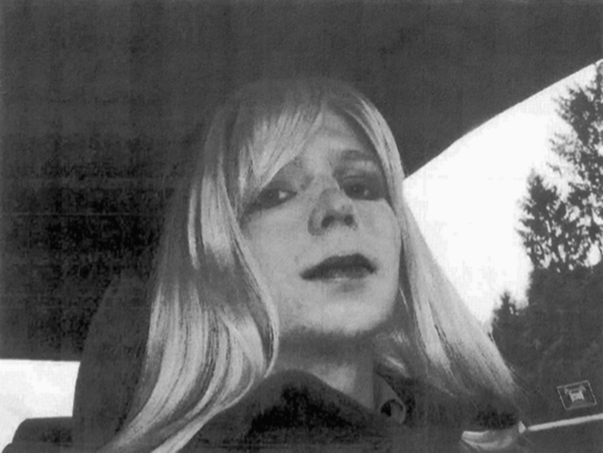 In  this undated file photo provided by the U.S. Army, Pfc. Chelsea Manning poses for a photo wearing a wig and lipstick. (AP Photo)