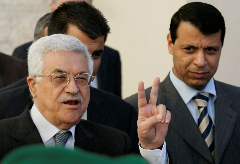 Palestinian Authority President Mahmoud Abbas and Mohammed Dahlan in the West Bank town of Ramallah.