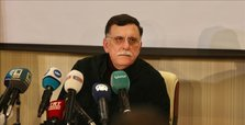 Libyan PM al-Sarraj plans to step down by end of October