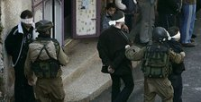 Israel holds dozens of Palestinians in overnight raids
