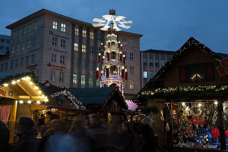 Visitors walk across the Christmas market in Kassel, Germany, Monday Dec. 12, 2016. (AP Photo)