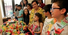 Students make origami cranes for world peace