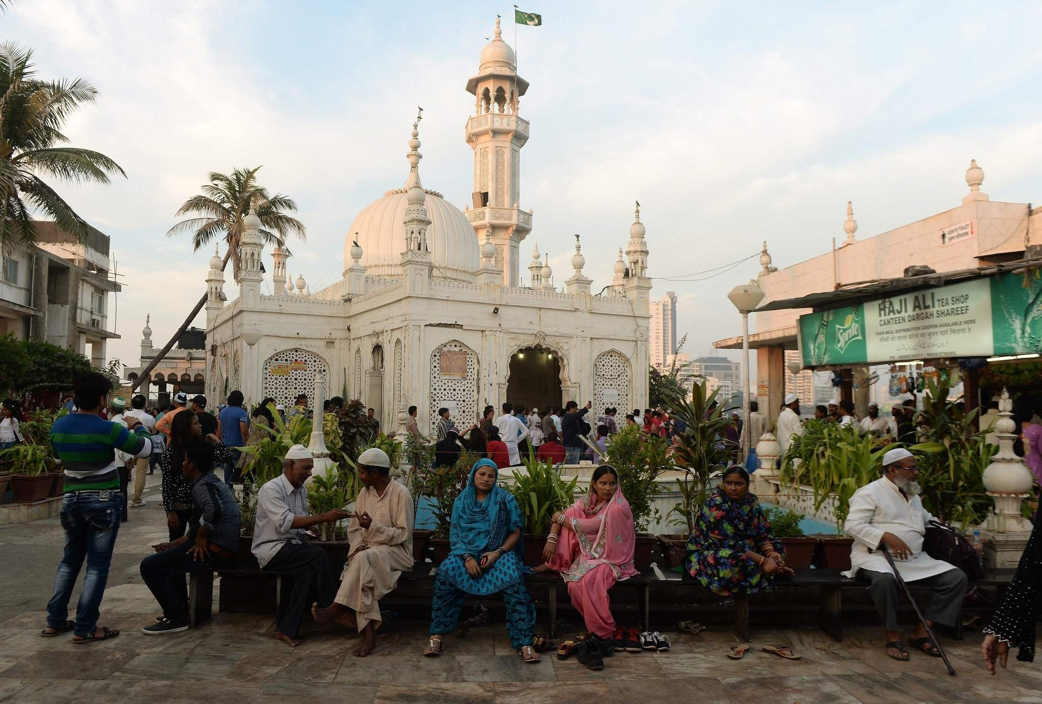 In this photograph taken on December 9, 2015, Indian Muslims and visitors are seen at the Haji Ali Dargah in Mumbai. (AFP Photo)